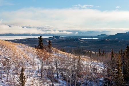yukon territory: Early autumn fall snow on remote wilderness landscape scenery of Lake Laberge in Yukon Territory, Canada