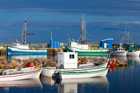 Colorful small fishing boats in harbor of Lanse Amour, Labrador, NL, Canada