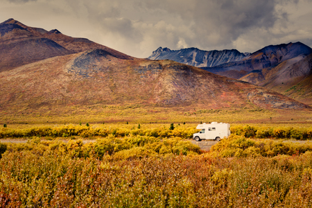 Dempster Highway Adventure, RV in fall color tundra landscape of Tombstone Territorial Park, Ogilvie Mountains, Yukon Territory, Canada 免版税图像