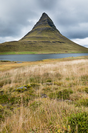 Famous touristic landmark attraction of Kirkjufell mountain and Grundarfjordur landscape scenery on Snaefellsnes peninsula, Iceland, IS, Europe