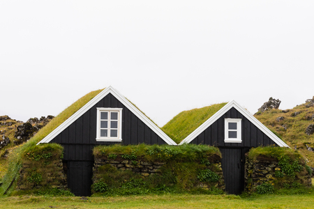 Historic farm house buildings with taditional grassy turf roof architecture in Hellissandur, Iceland, IS, Europe