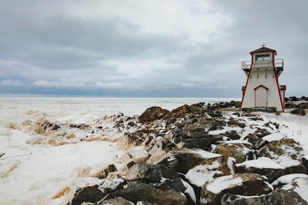 Frozen Atlantic Ocean off seashore at Arisaig Lighthouse in Antigonish County, Nova Scotia, NS, Canada