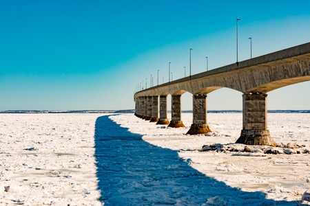Confederation Bridge over sea ice to PEI Canada 写真素材