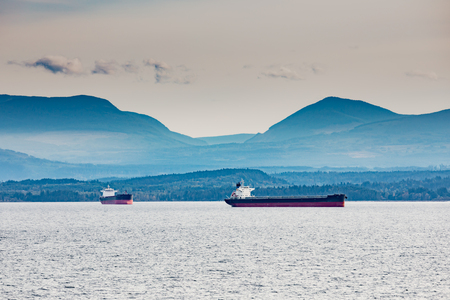 Tanker ships at anchor offshore Vancouver Island 写真素材 - 118487619