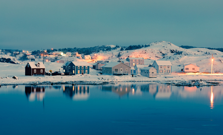 Calm winter evening in Durrell Harbour neighbourhood of outport town of Twillingate, Newfoundland, NL, Canada 写真素材