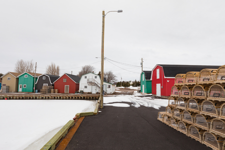 Still winter on wharf but lobster traps already prepared, village of French River, L21, Kensington County, Prince Edward Island, PEI, Canada 写真素材