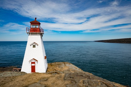 Bay of Fundy coastline and Boars Head Lighthouse near Tiverton on Long Island, Nova Scotia, NS, Canada 写真素材