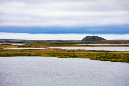 Frost heave ice core hill called Pingo of Pingo Canadian Landmark rising from Tundra near Inuvialuit town of Tuktoyaktuk, Northwest Territories, NWT, Canada 写真素材 - 118488114