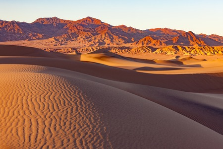Mesquite Sand Dunes and distant mountains in Death Valley National Park, California, USA