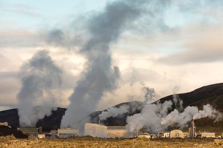 Steam and vapor rising from Svartsengi Geothermal Power Plant beside Lagoon near Grindavik, Iceland, IS. Europe