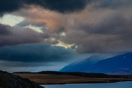 Storm clouds at sunset over Eyjafjordur fiord forming dramatic skyscape near Akureyri, Iceland, IS, Europe 写真素材 - 118488350