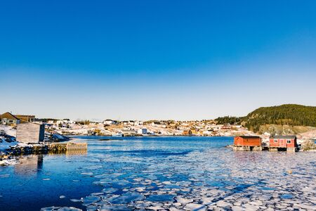 Beautiful winter day in outport town of Tizzards Harbour on New World Island, Newfoundland, NL, Canada