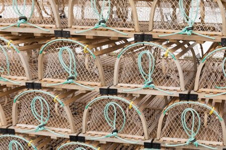 Background texture pattern abstract of stacked lobster basket traps ready for lobstering on Prince Edward Island, PEI, Canada Reklamní fotografie - 133997853