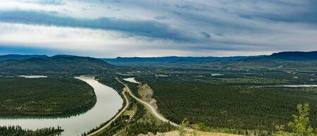 Yukon River at Carmacks summer landscape along North Klondike Highway, Yukon Territory, YT, Canada Reklamní fotografie - 133997854