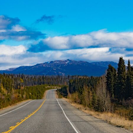 Alaska Highway Alcan in great empty nature wilderness landscape of Southern Yukon Territory, YT, Canada