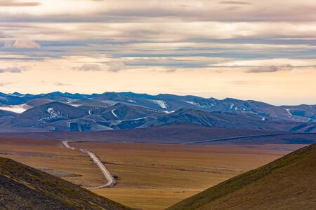 Dempster Highway in arctic tundra of Richardson Mountains north of arctic circle, Yukon Territory, YT, Canada 写真素材 - 132019434
