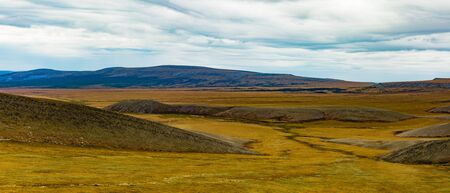Panoramic arctic tundra landscape fall colors north of arctic circle near Dempster Highway, Yukon Territory, YT, Canada 写真素材 - 132019769