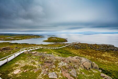 Boardwalk in coastal tundra landscape near town of Red Bay, Labrador, Province of Newfoundland and Labrador, NL, Canada Banque d'images - 132019281