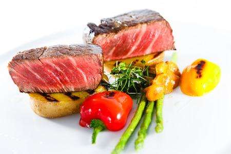 marble beaf stake vegetables white plate Stock Photo