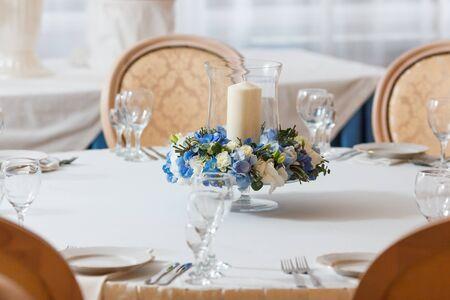 white table candle blue flowers  arrangement decoration interior
