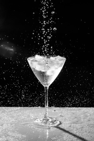 black and white water drops and sprinkles plain background