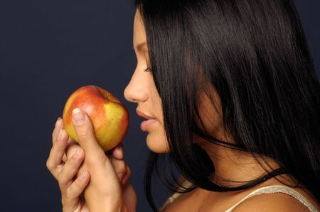 fateful: Beautiful exotic girl with long hair is keeping the apple