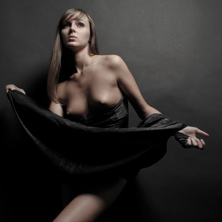 Beautiful  girl with long hair in dreaped dress