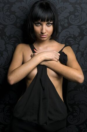 Beautiful brunette girl in black dress with crossed arms Stock Photo - 4379097
