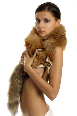 Portrait of the beautiful naked girl with furs photo
