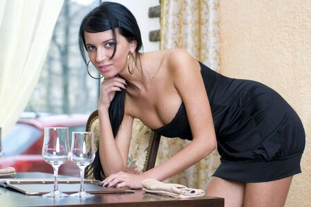 dinning: Beautiful woman in restaurant is reading the menu