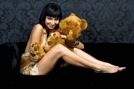 Beautiful girl is playing with teddy bear. Fun Stock Photo - 4631321