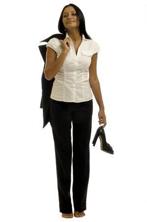 after to work: Bella empresaria es relajante despu�s del trabajo. Sin zapatos. Foto de archivo