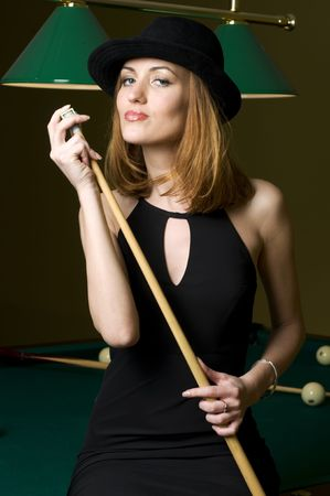 Portrait of the beautiful blonde woman with cue photo