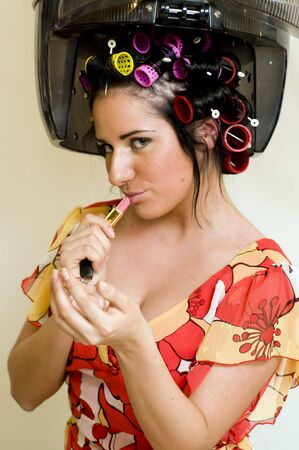 Portrait of the beautiful woman with curlers and lipstick Stock Photo - 4941412