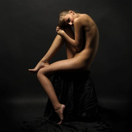 Portrait of the sitting beautiful naked woman