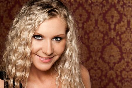 Portrait of the beautiful young blonde woman photo