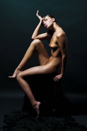Portrait of the beautiful naked sitting woman