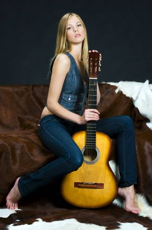 Portrait of the beautiful blonde girl with guitar photo