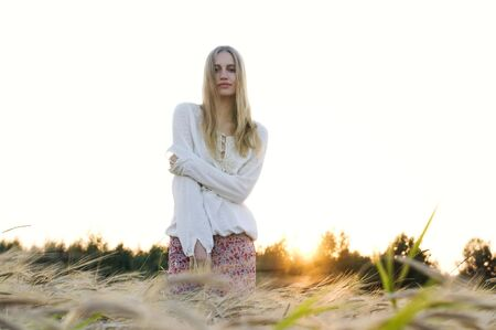 Portrait of the beautiful blonde at the rye field photo