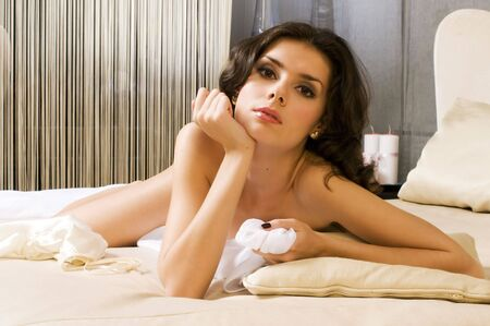 Portrait of the beautiful naked woman in a bedroom Stock Photo - 5652270