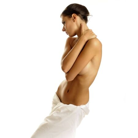 Portrait of the beautiful naked woman in a towel