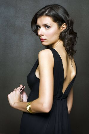 Portrait of the beautiful elegant woman in a black gown photo