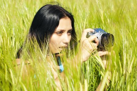 Portrait of the beautiful woman with a camera  photo