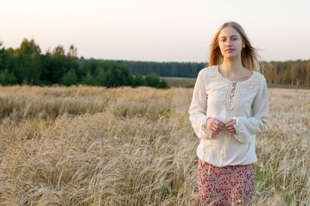 Portrait of the beautiful woman at the rye field photo
