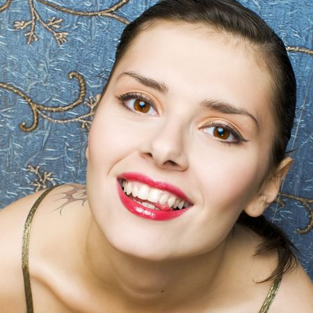 Portrait of a beautiful woman with tooth smile photo