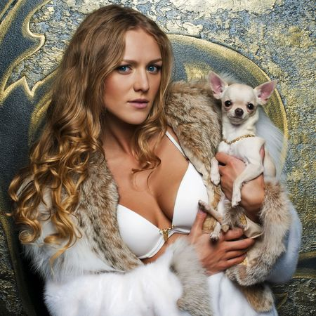 Portrait of the beautiful woman in furcoat with chihuahua photo