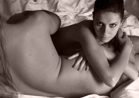 nude in bed: Beautiful naked woman is holding a naked man. Monochrome