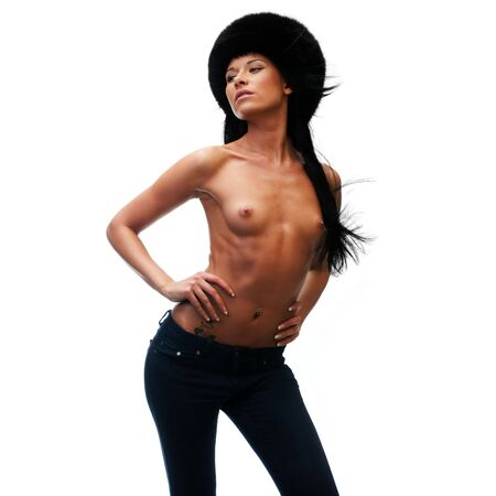 Portrait of the beautiful naked woman with a fur hat Stock Photo - 6105285