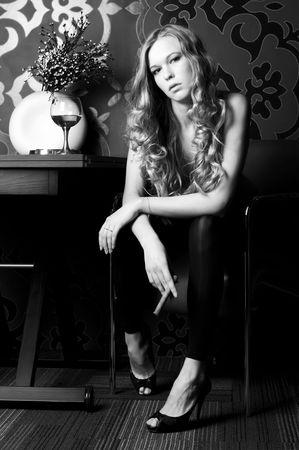 cigar smoking woman: Portrait of the  beautiful woman with cigar. Monochrome image Stock Photo