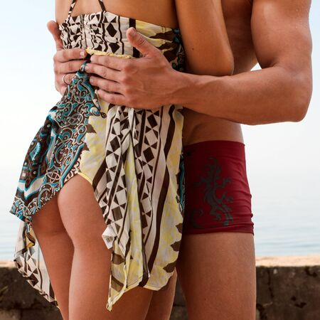 Young beautiful couple are kissing at the sea Stock Photo - 7902792